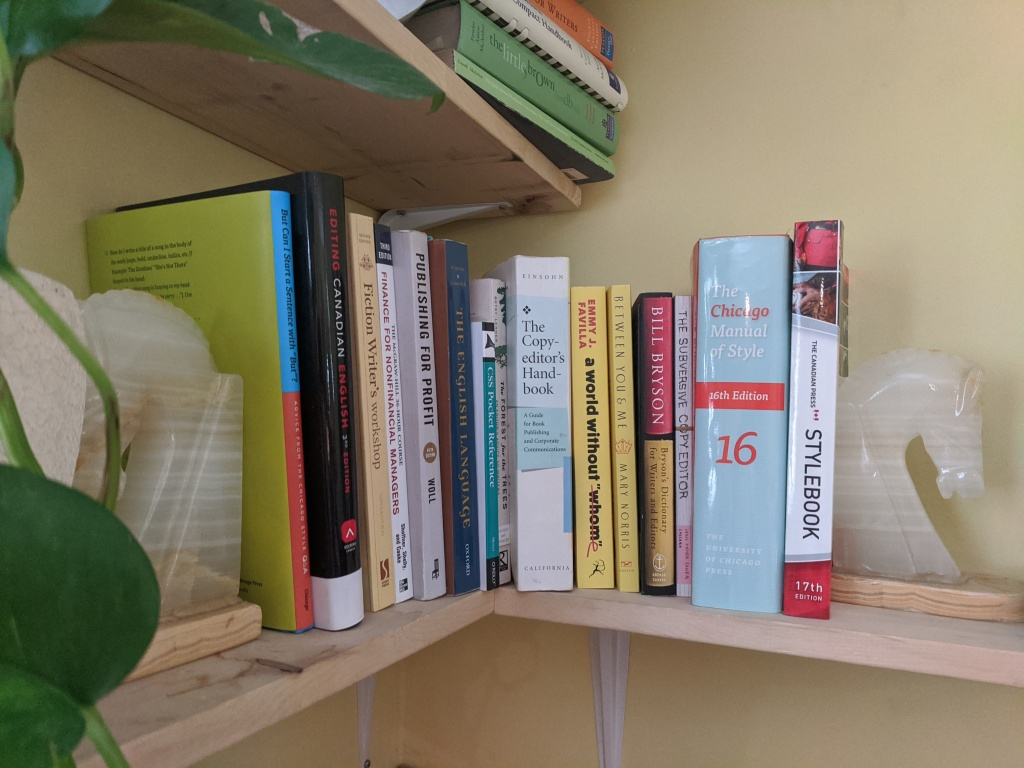 Side bookshelf filled with book editing and publishing resources